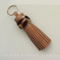 Tassel keychain with fur top https://www.etsy.com/listing/244059908/tassel-keychain-tassel-bagcharm-tassel