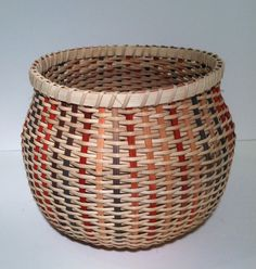 This basket is woven using a 2-1 twill pattern with 3mm flat oval natural reed. It sits approximately 6 1/2 inches high and is approximately 8