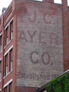 J. C. Ayer Co. ghost sign in Lowell, Massachusetts.