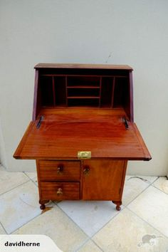 similar to style of desk I want to create eventaully as acraft table area for me... old writing desk with loads of storage and drop down desk space