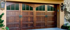 Custom wood garage door with ring handles.  See more at www.ontracdoors.com