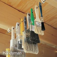 Hang your paintbrushes out of harm's way by installing a couple of screw eyes or cup hooks on the bottom of a couple of rafters or floor joists. Then thread the brush handles through a stiff wire (or welding rod) and hang it all up.