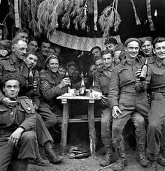 Canadian soldiers enjoying a few drinks on Christmas Day at the front, Ortona, Italy, December 25, 1943