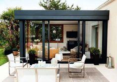 Véranda à toiture-terrasse