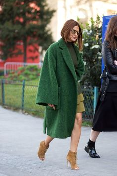 Opt for warmer colours when wearing an emerald green teddy bear style coat.