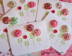 """""""I saw these wonderful button note-cards at How About Orange. You just download the PDF for the card, print it up and add the buttons. But I thoughts some baby yo-yos would be great. I also rounded the edges of the card.""""  JoAnn"""
