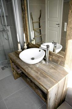 rustic country vanity in an updated bathroom. Like the contrast of the smooth white modern sink w the wood