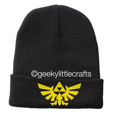 "Inspired by the popular video game! Machine embroidered beanie, finished off on a cuffed beanie. This beanie would be a perfect gift for anyone or a perfect gift for yourself.  Turnaround time: 2-3 weeks  Beanie Info: Super Dense Knit 100% Hypoallergenic Acrylic Length: Approximately 12"" (u..."