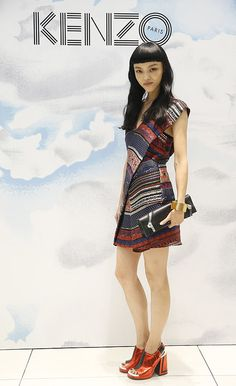 Rila Fukushima helped open Kenzo's Shanghai boutique in the label's printed mini.