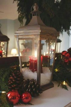 Thinking of doing this with my lanterns and white LED candles with snow. So rustic for Christmas. Christmas Lanterns, Noel Christmas, Winter Christmas, All Things Christmas, Christmas Crafts, Christmas Ideas, Christmas Candle, Elegant Christmas, Xmas Decorations