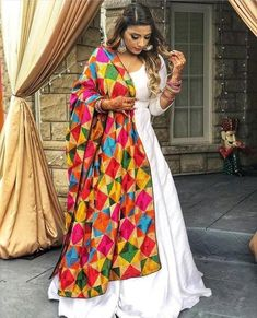 Designer dresses indian - Silk long white gown full flaired floor length custom made dress with punjabi fulkari phulkari dupatta indian womens party wear dresses – Designer dresses indian Indian Party Wear, Indian Wedding Outfits, Pakistani Outfits, Indian Wear, Indian Outfits, Indian Gowns Dresses, Robe Anarkali, Silk Anarkali Suits, Phulkari Punjabi Suits