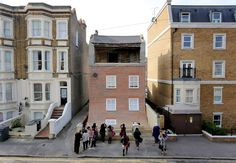 Artist makes house slide into the street - but it's all just an optical illusion - Mirror Online