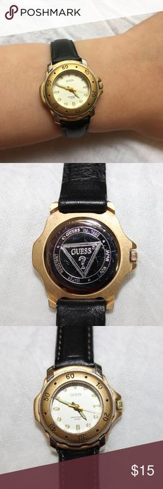 Vintage Guess Ladies Watch - 1992 Vintage Guess ladies watch (circa 1992) with white face, and gold bezel. The dots and hands glow in the dark, and the bezel turns.  Face is 1 inch in diameter.  Fits wrists up to 7 inches, genuine leather band black with white stitching. Watch is water-resistant. Needs a battery. Guess Accessories Watches