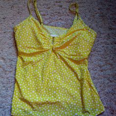Simply swim yellow polka dot tankini swim top Super cute yellow polka dot tankini top. Has adjustable straps. Size juniors 16. Fits more like a 10/12 and up to a c cup new and never worn. Simply Be Swim