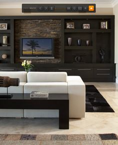 Love this wall unit and the TV mounted on stacked stone.