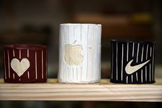 Wooden shrinkboxes (with logos), painted and carved.