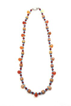 """The freshness of the turquoise colour mixed with the carnelian stones is always a summer favorite. It adds whimsy to a plain white t shirt and jeans. The chevron Italian beads are vintage and are distinguished by it's chevron design throughout the bead.    Necklace measures 16"""".   Carnelian Mix Necklace by The Story Of Love. Accessories - Jewelry - Necklaces Toronto, Canada"""