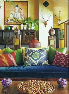 Bohemian. Every color on the couch #upholstered #upholstery #pillows