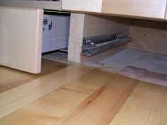 Toe kick drawers. WHY waste the space under your cabinets?? USE IT!! I think this would be great in a bathroom for your blow dryer, curling irons, all that stuff!!!