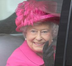 Queen Elizabeth's hot pink feathered hat details during the 50th anniversary of the National theatre event on 22.10.13