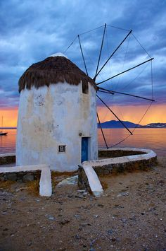 Sunset over the traditional windmills of Mykonos island, Greece