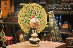 Prachin Special Hand Made Peacock With Pure Gold Work.  Available in different sizes in stores. The Best Collection From Artist Across India In Stores Now.  More Range & Varieties Visit Our Showroom's. For More Information, Visit Us :- www.prachin.co.in Mail Us :- info@prachin.co.in Call Us At :- +91-9741111055, +91-9741111066 For More Updates Or Any Q&A Leave Us A Message At : www.facebook.com/prachinartandcrafts