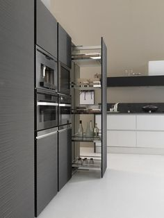 Pull out pantry and I love the vertical lines in this cabinetry finish