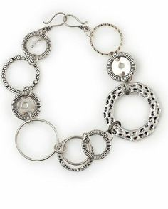 "Isis- 20"" Antique silver hoops with polished, hammered and stippled designs are joined in this dynamic necklace that can also be added to a longer chain. $32 #isis #yourstylemialisia"