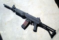""""""" Century Arms Golani """"SAR"""" A U.S made copy of the Israeli assault rifle, the Galil. This particular Golani has two interesting modifications. The barrel was shortened and a SAR muzzle brake was added..."""