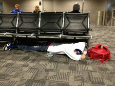 this is how he sleeps at the airport