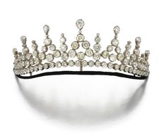 DIAMOND TIARA, LAST QUARTER 19TH CENTURY,  Designed as a graduated row of tiered dart motifs, set with circular-cut, cushion- and pear-shaped diamonds, inner circumference approximately 235mm, fitted case, formerly a necklace/tiara and converted to sole use as a tiara in the early 20th century.
