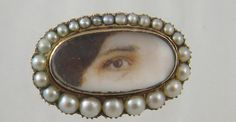 Rare Gold and Seed Pearl Framed Miniature Lovers Brown Eye of a Woman.Eye is approx. 1/2 by 1 inch and framed is 3/4 by 1 1/4 inches. Tests 10 to 12