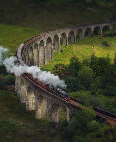 'Hogwarts Express' passing through the Glenfinnan Viaduct, Scotland