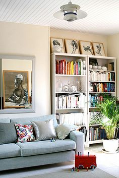 prints on top of bookcases