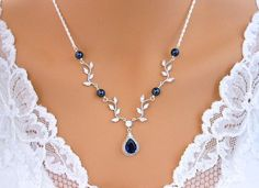 Blue Wedding Necklace Y Bridal VINE Necklace Sapphire Blue White or Ivory PEARLS Sterling Silver This listing is for the NECKLACE ONLY! Matching Earrings link: https://www.etsy.com/listing/448754570/blue-wedding-vine-earrings-navy-sapphier Feminine and Vintage inspired. This delicate gorgeous necklace features Vine design components encrusted with tons of tiny Cubic Zirconia embellished with Swarovski crystals Midnight Blue pearls (available in white, ivory and other pearl colors)…