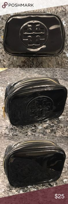 Tory Burch Cosmetic Bag Black Tory Burch cosmetic bag with glossy finish. Approximately 8 in wide, 6 in tall, and 3 in deep. Lightly used and in good condition. Barely noticeable small white marks on bottom of logo as shown in pictures. Tory Burch Bags Cosmetic Bags & Cases