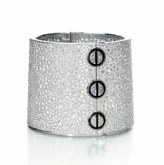 A UNIQUE DIAMOND AND ONYX 'LOVE CUFF', BY CARTIER