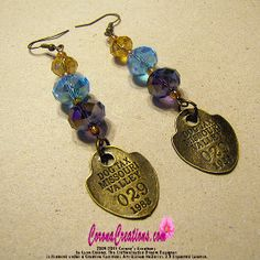 Who Let The Dogs Out. Earrings of Glass Crystals,and antique bronze dog license tags.