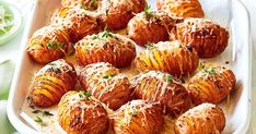 These hasselback potatoes are the perfect side dish, baked with paprika and topped with parmesan cheese.