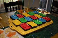 Cut brownies into rectangles, cover with colored cream cheese frosting and MandM's.  Easy Lego Brownies! #LegoDuploParty