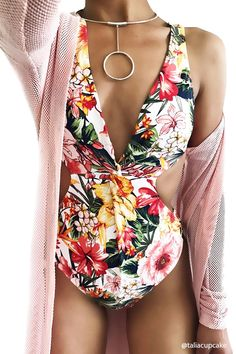 A one-piece swimsuit featuring an allover tropical floral print, a surplice V-neck front, a cutout back, and a cheeky leg cut.