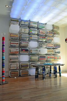 Use a jigsaw to remove the bottoms of a bunch of Trovast bins and then screw them to the wall to create an incredibly modern storage solution. | 33 Unexpected Things You Can Make With Ikea Products