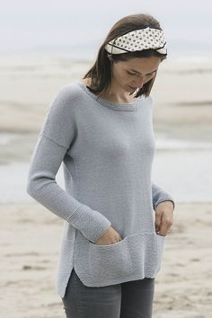 Simple meets modern in this Tern pullover designed by Pam Allen. Worked from the bottom up, Leda has all the makings of a great sweater: Shapely garter stitch hems and deep cuffs, pockets, short-row shaping at the shoulders for a flattering fit, and an easy, open neckline.