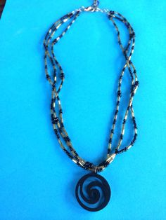 Black and Gold Swirl Charm Necklace on Etsy, $12.50