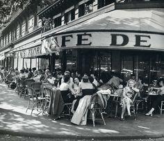 France. Outside the Cafe de Flore, Saint-Germain-des-Prés, Paris, 1952 // Robert Capa