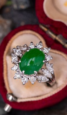 This beautiful vintage ring is centered with an oval, untreated jadeite cabochon, weighing carats, in a six-prong setting. The center accented with eight round brilliant cut diamonds and six marquise brilliant cut diamonds. The ring measures Mom Jewelry, Jade Jewelry, Jewelry Rings, Jewellery, Vintage Diamond, Vintage Rings, Diamond Shapes, Diamond Cuts, Jade Ring