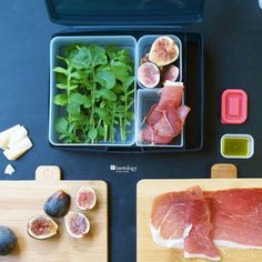 Bamboo Cutting Boards with Bentology Bento Box Salad with Figs, Prosciutto, Arugula and Parmesan ready for lunch in a bento box set