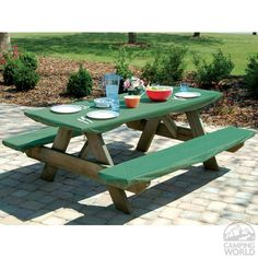An adjustable picnic table cover with its own cover and pockets on ...