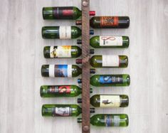 Articoli simili a Wall Mounted Wine Rack : Thin - holds 8 bottles - white, blue, red, orange, green, yellow stripes su Etsy
