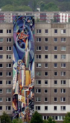 Jose Renau – Halle Neustadt, Germany:  Over 10 story high abstract ceramic mosaic mural.